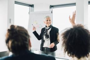 Woman giving a presentation to an office group