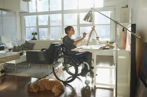 Woman in wheelchair at easel