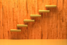 Yellow floating steps on a wooden wall