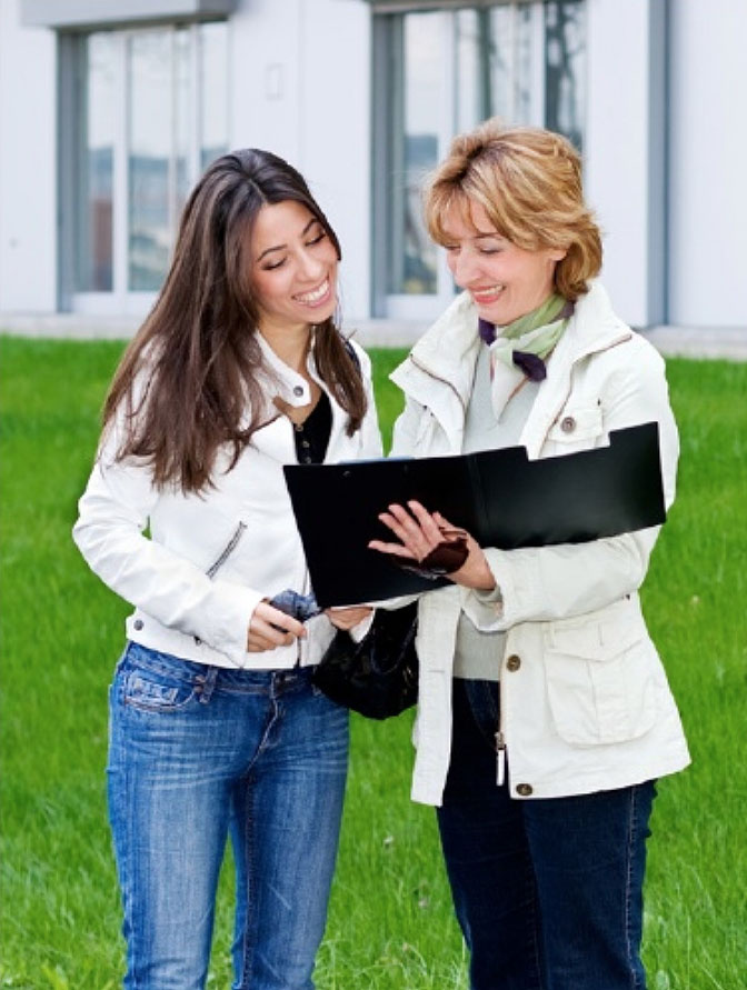 Two women looking at a portfolio