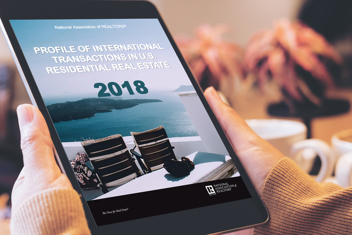 Cover of the 2018 Profile of International Transactions in U.S. Residential Real Estate on a tablet