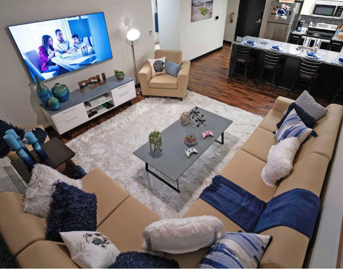 Staged dorm living room with TV