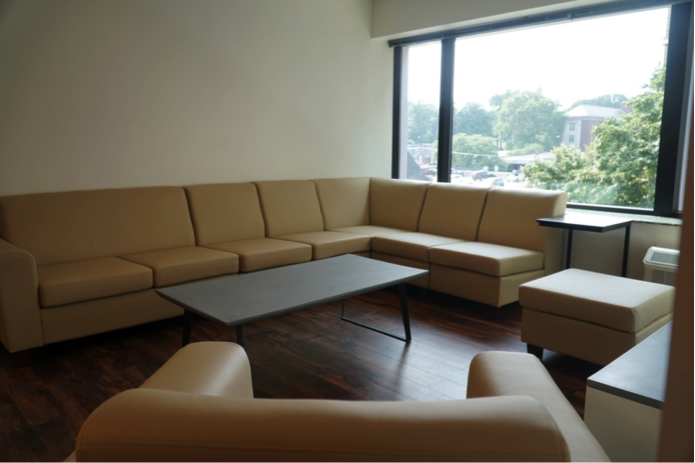 Plain beige couches in a dorm room