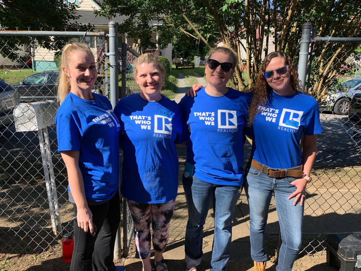 Four Chattanooga REALTORS® in That's Who We R Shirts