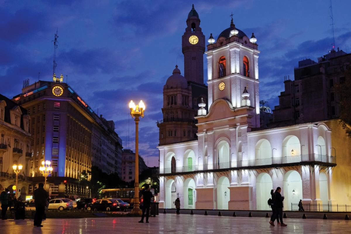 European clock tower, downtown at night