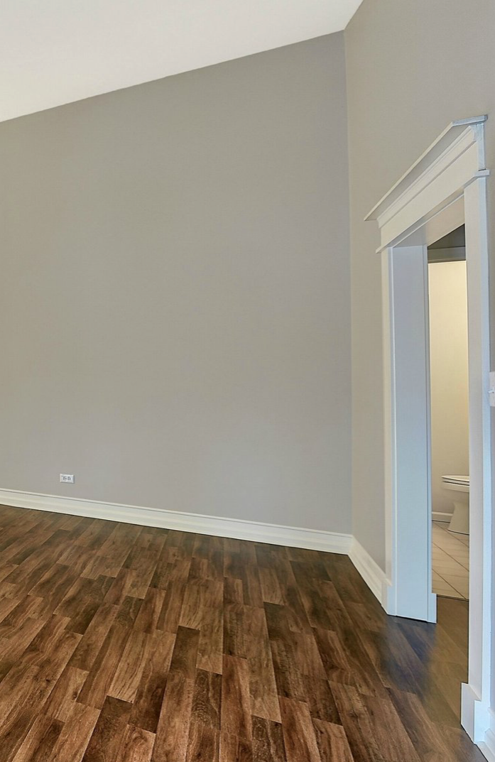 Home interior, grey walls, white trim, wood floors.