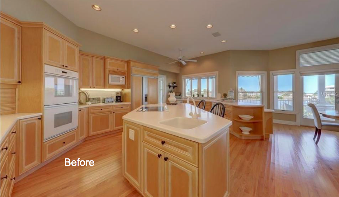 Kitchen with island, and pine colored cabinets