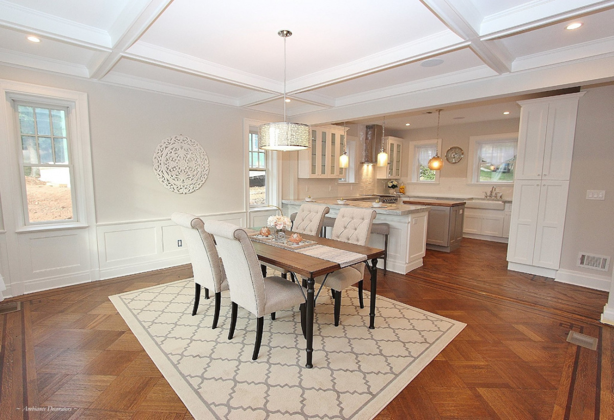 A dining room after renovation, stated with tables chairs and rug.