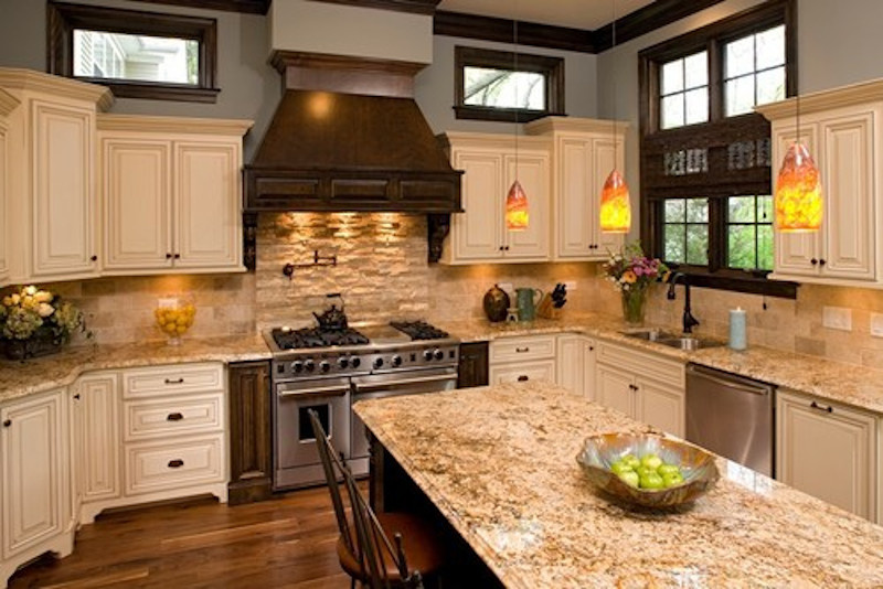Kitchen with wood stained wall accents and darker exhaust hood