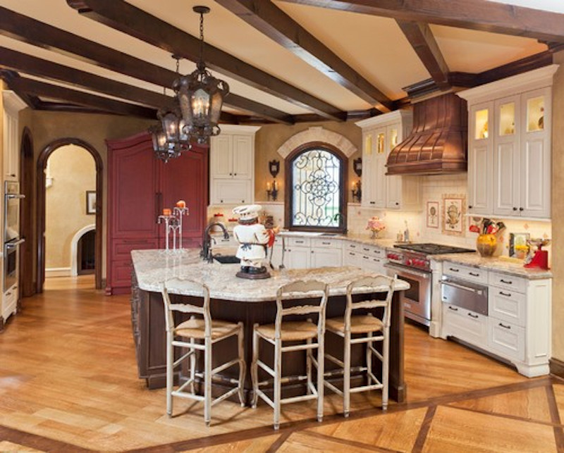 Kitchen with coffered ceilings and dark brass exhaust hood