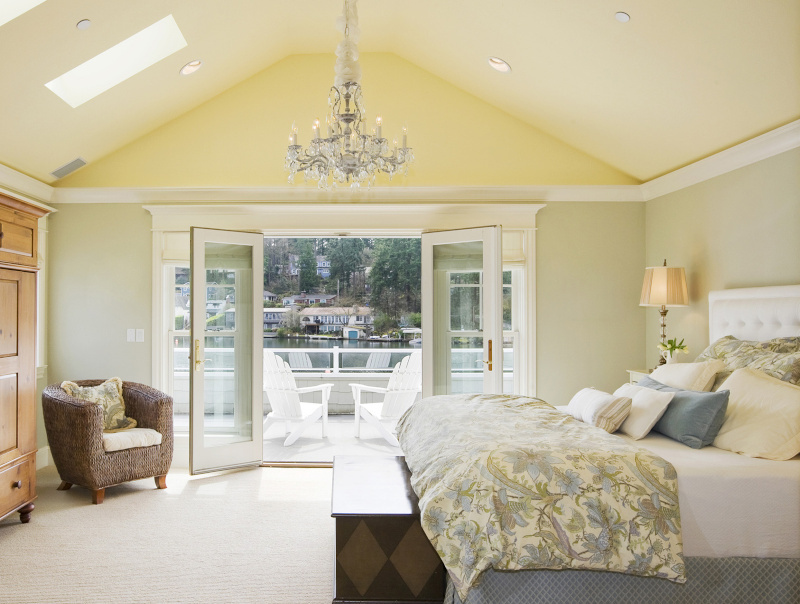 Master bedroom with french doors leading to balcony