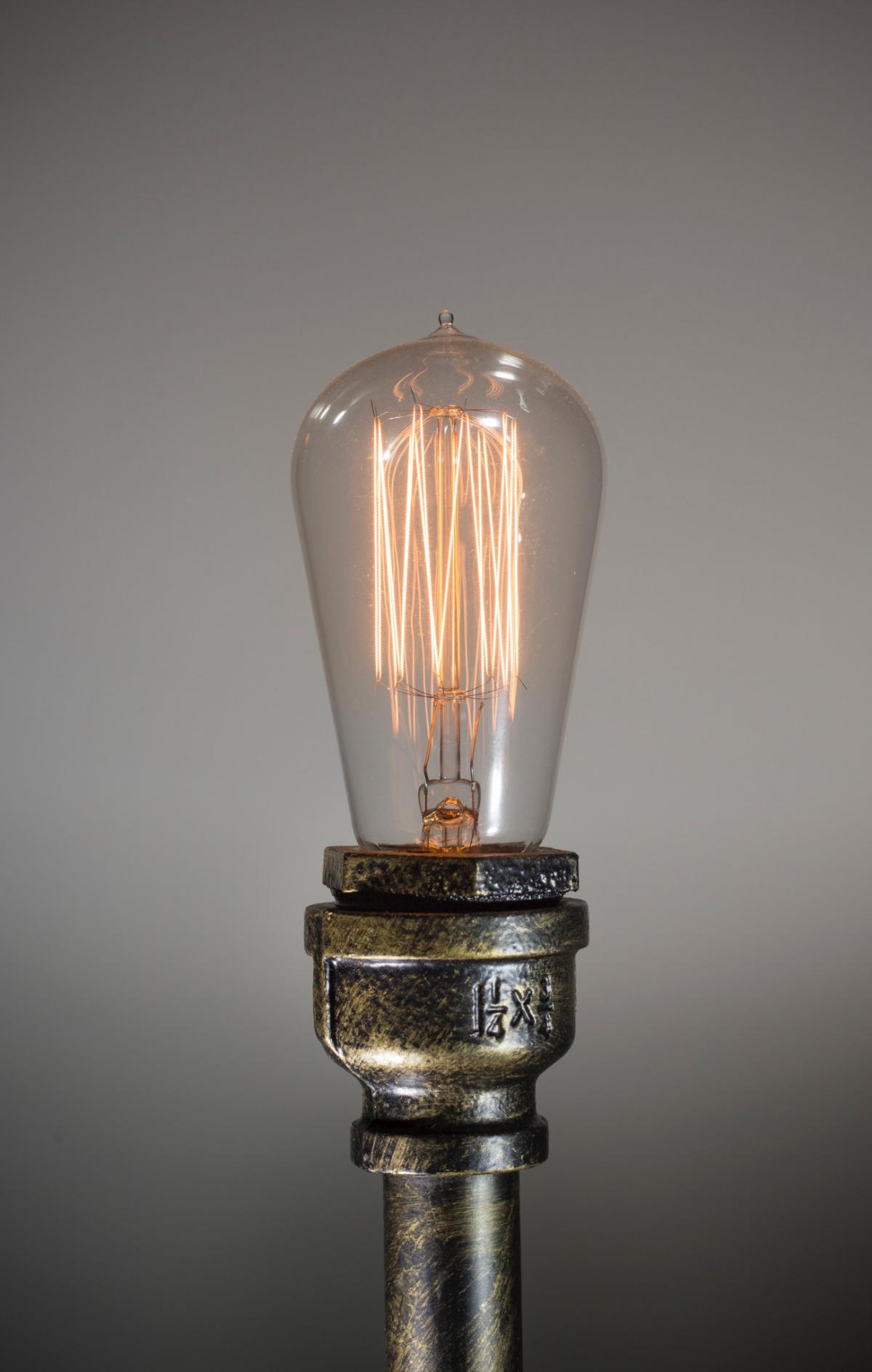 An edison lightbulb on a pipe lamp