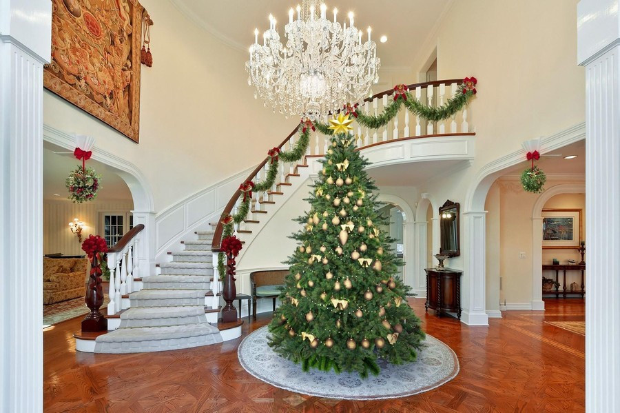 Christmas decorated entry staircase