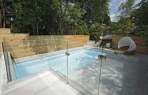 A modern pool with a glass enclosed overlook