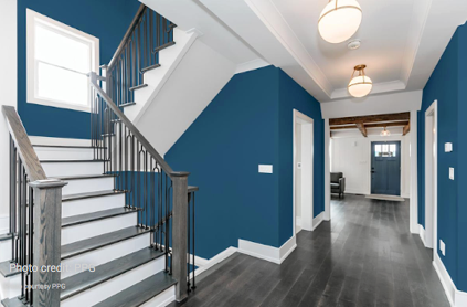 Blue hallway and stairwell with white accent.