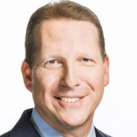 Headshot image of Scott Frisch of AARP.