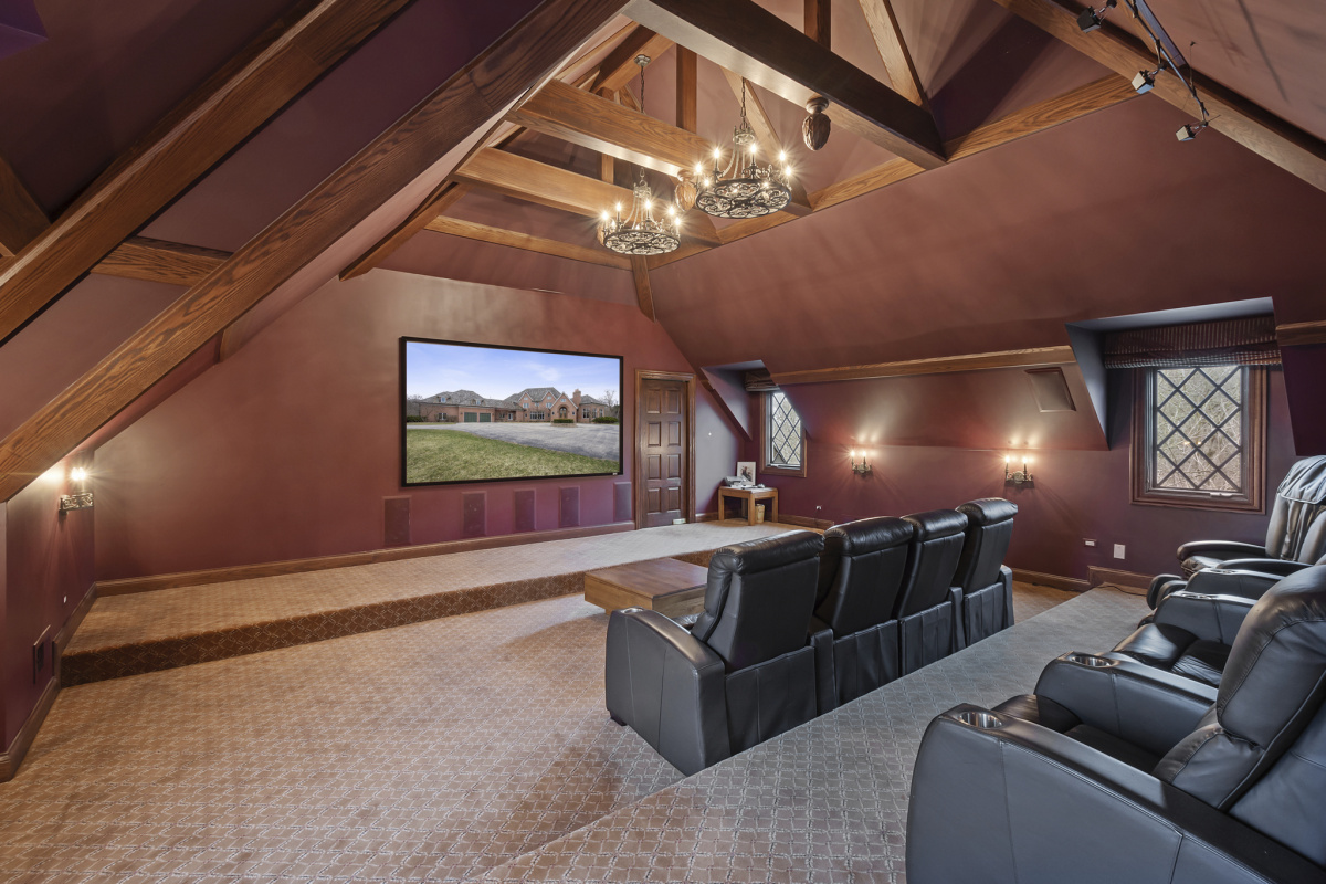 Home theater in luxury house with vaulted ceiling