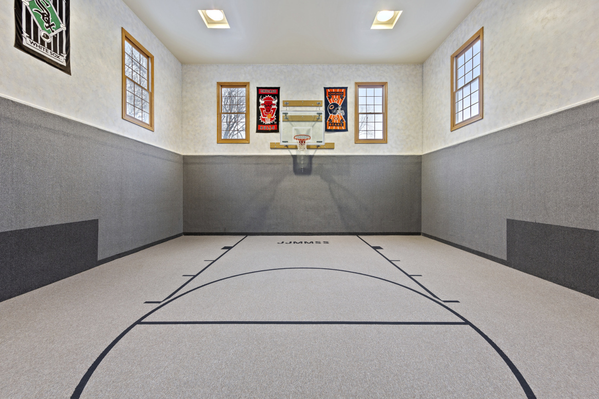 An indoor home basketball court