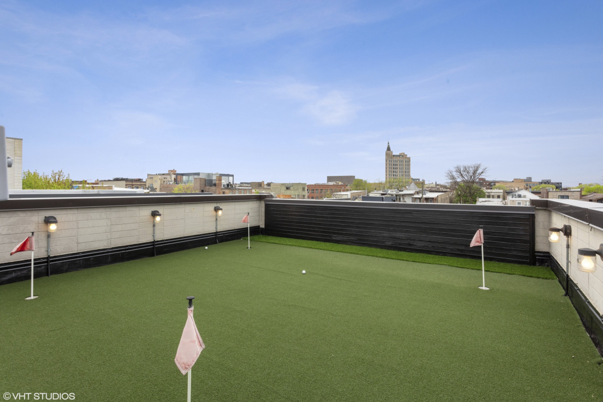 An artificial putting green on a home's rooftop.