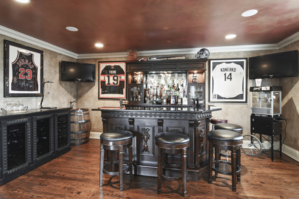 A home bar with sports memorabilia