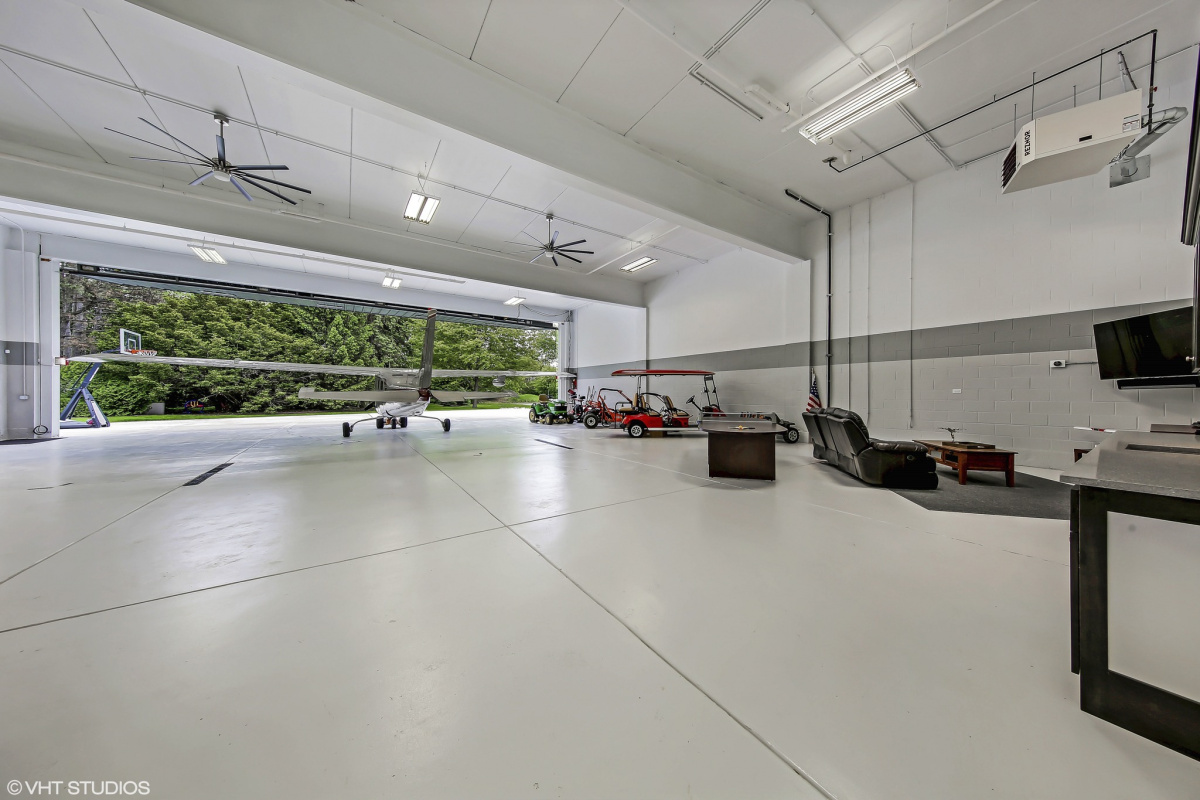 Small airplane hangar in luxury home