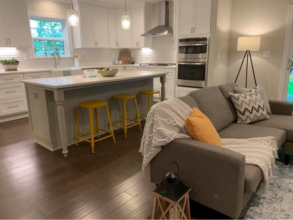 Gray open kitchen with yellow accents