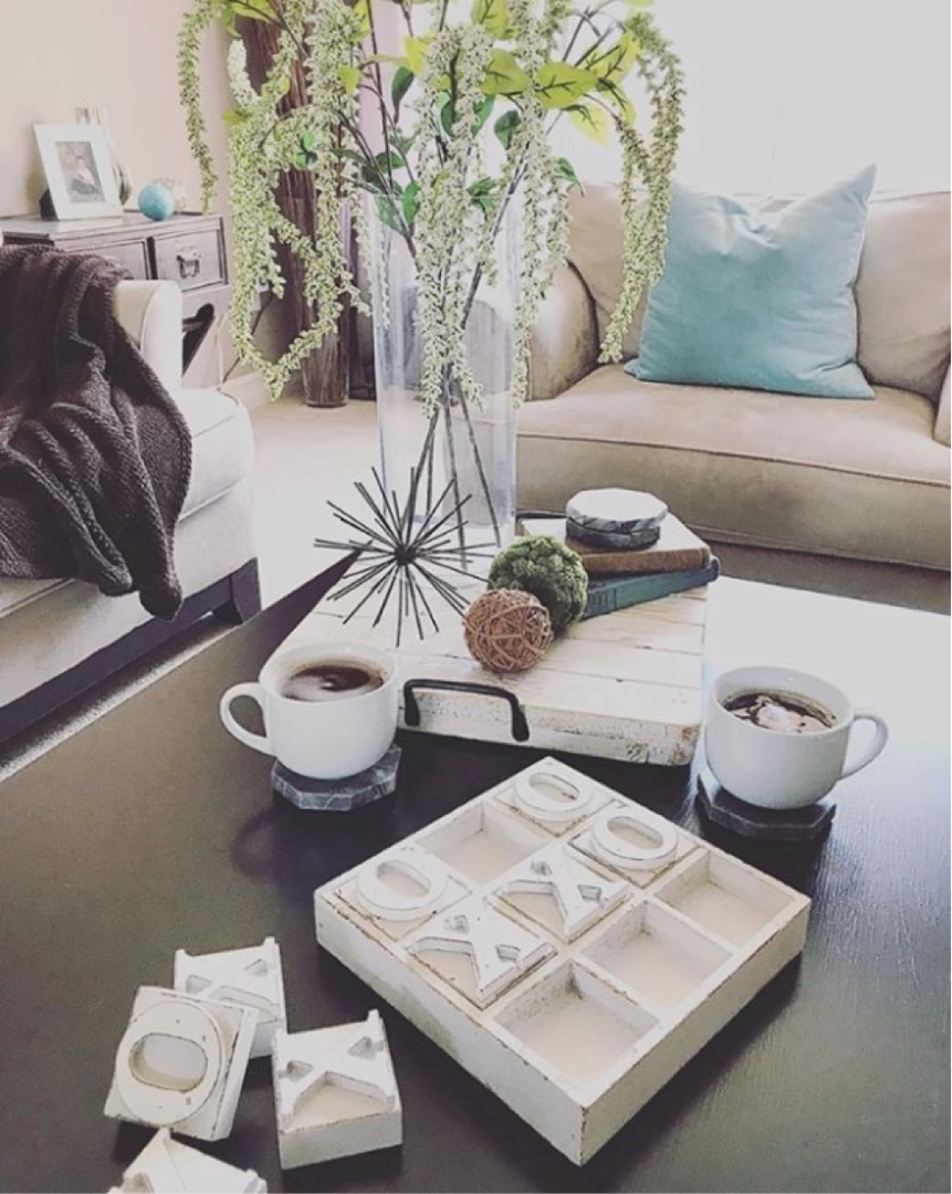 another photo of a coffee table staged with plants