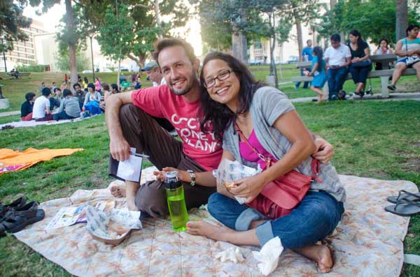A couple enjoys a picnic before a free concert at Levitt Los Angeles