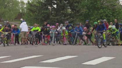 Bike parade from Southmoor Park on S. Oneida Way and S. Peach Way to Southmoor Elementary School (credit: CBS).