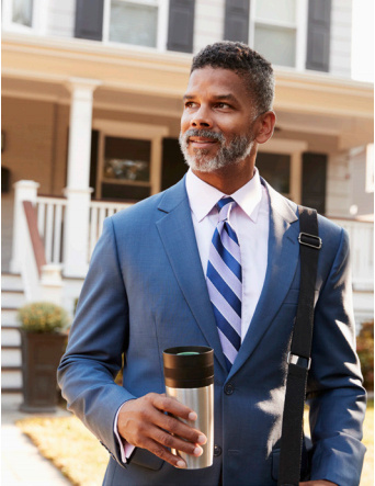 Businessman holding insulated cup