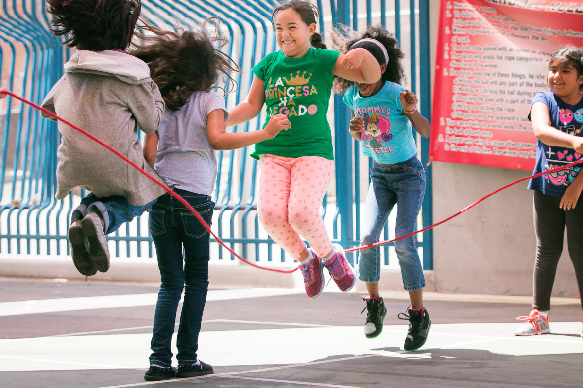 Children jumping rope at a park