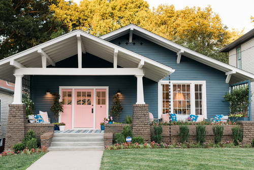 Blue and pink Craftsman style house exterior
