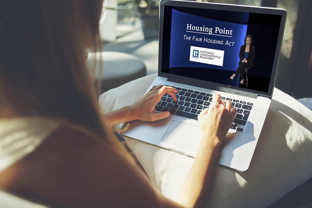 Fair Housing Video Playing on Laptop