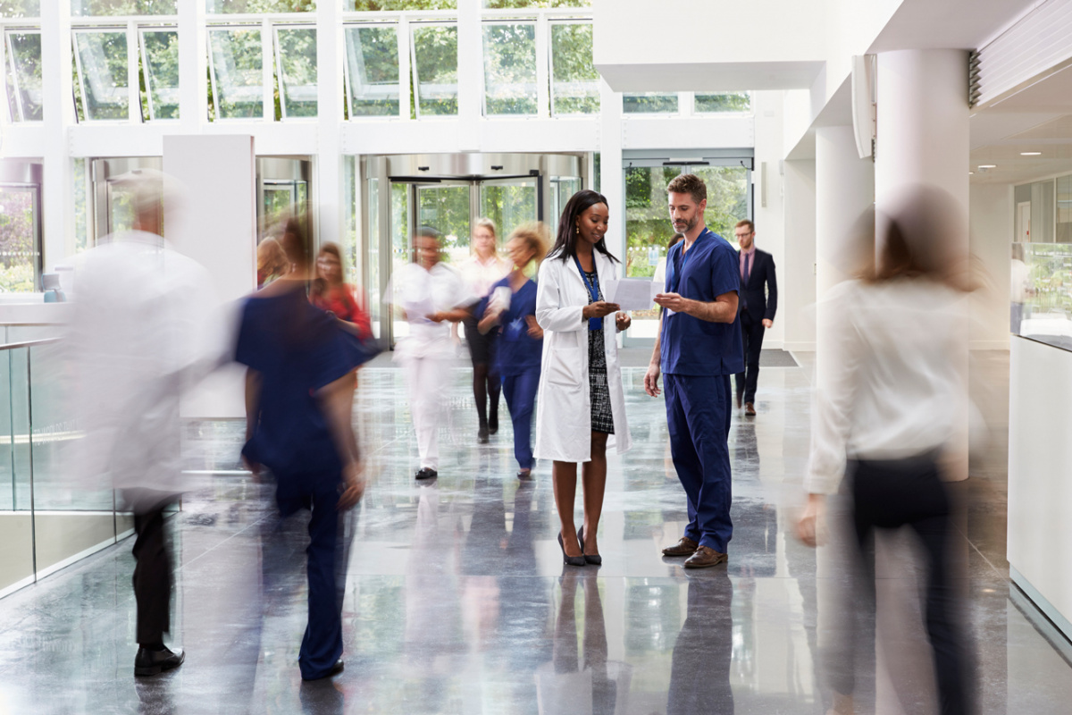 Healthcare - Doctors in Busy Hospital Lobby