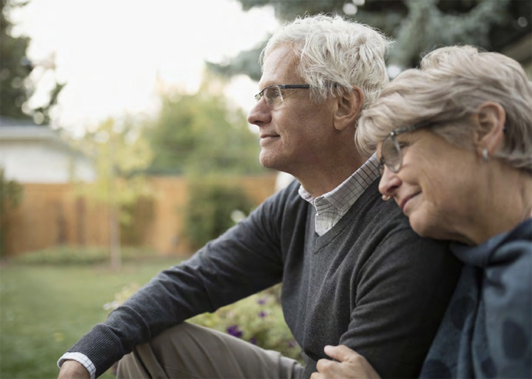 Older couple sitting in backyard