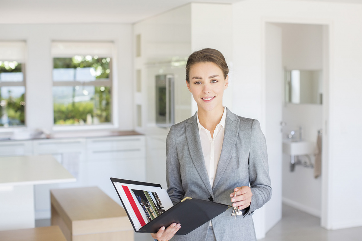 Professional woman holding a portfolio in a home