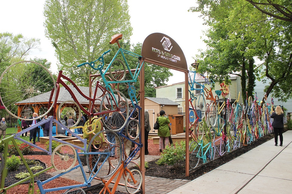 Entrance to the Boys and Girls Club in Mercer County, NJ featuring a colorful fence made of bicycle parts.