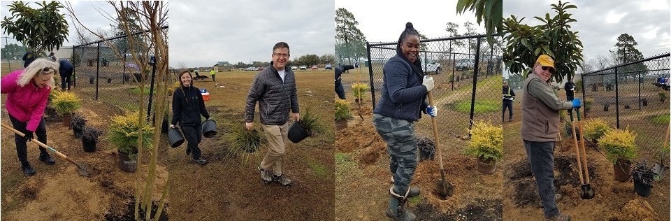 A group of CCAR REALTORS® and affiliate volunteers help plant trees and bushes alongside the fence in the East Bay Park