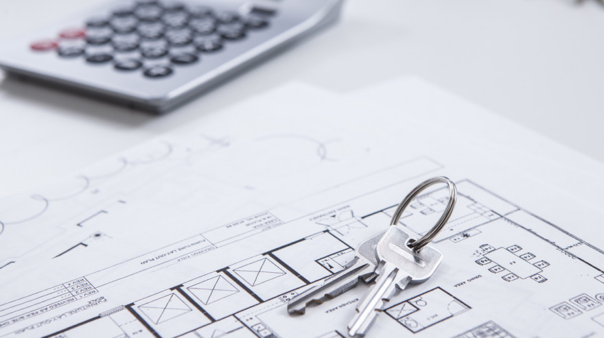 Keys, home floor plan, and calculator for home appraisal.