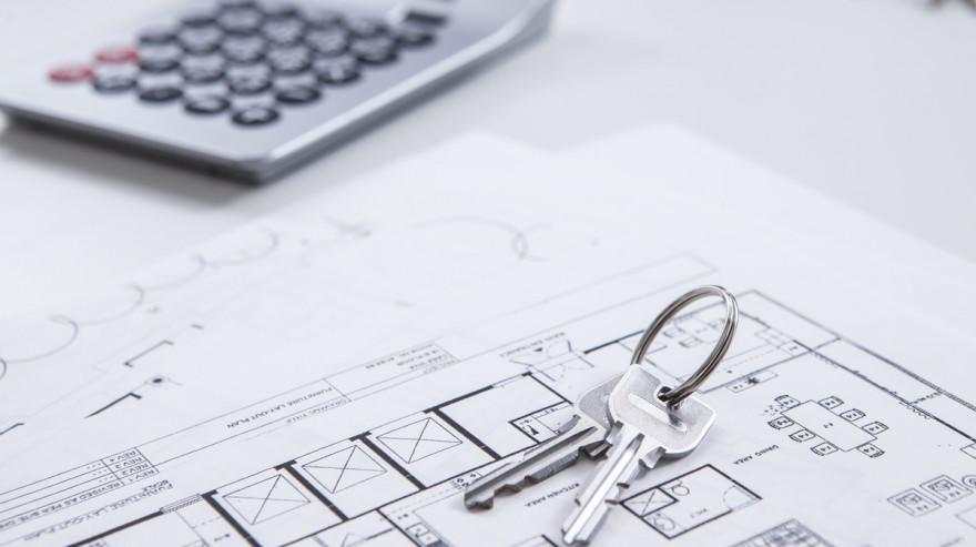 Keys, home floor plan, and calculator for home appraisal.