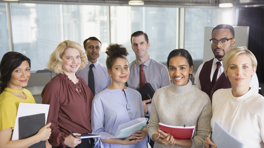 Group of business people holding notebooks and folders