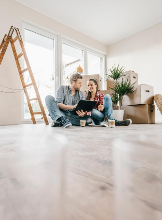 Couple Sitting on the Floor of Their New Home