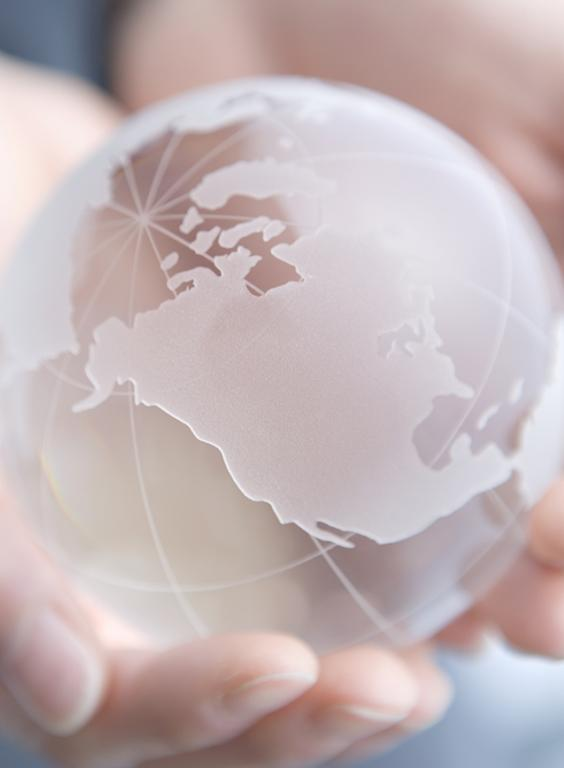 Frosted glass globe in hands