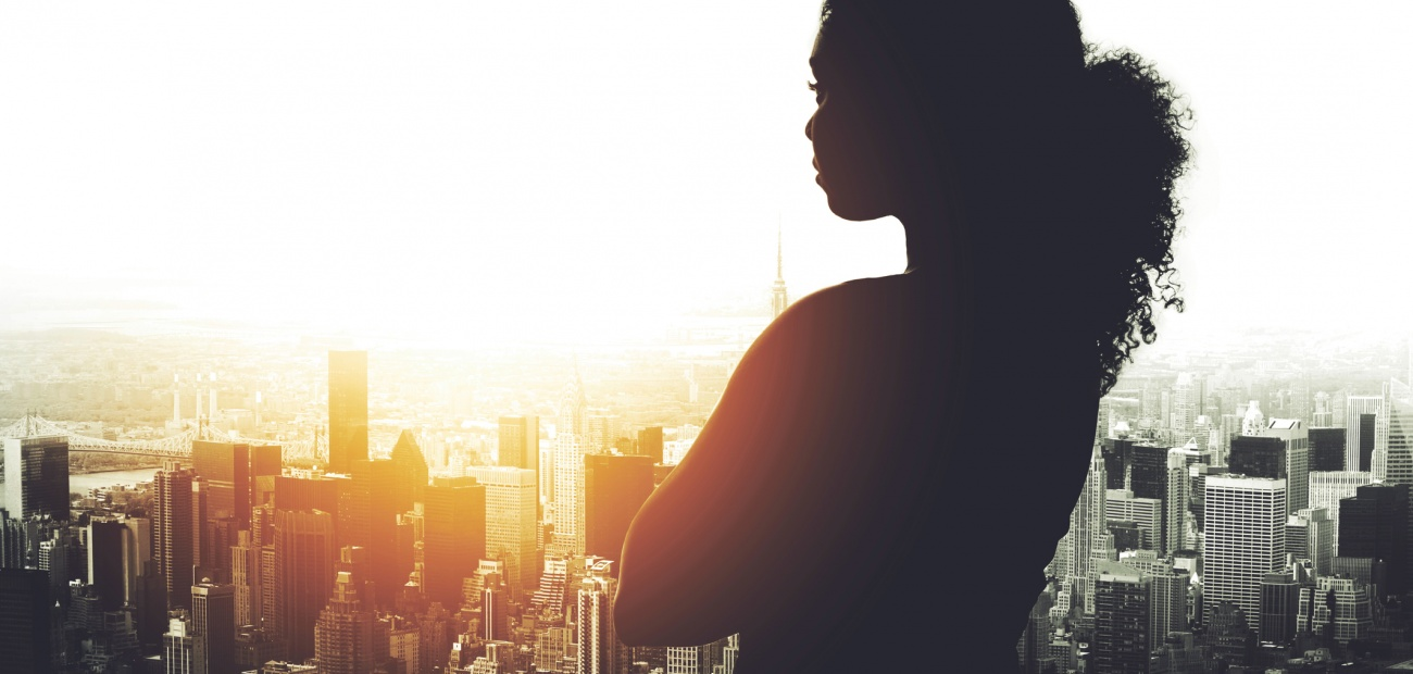 Business woman overlooking cityscape