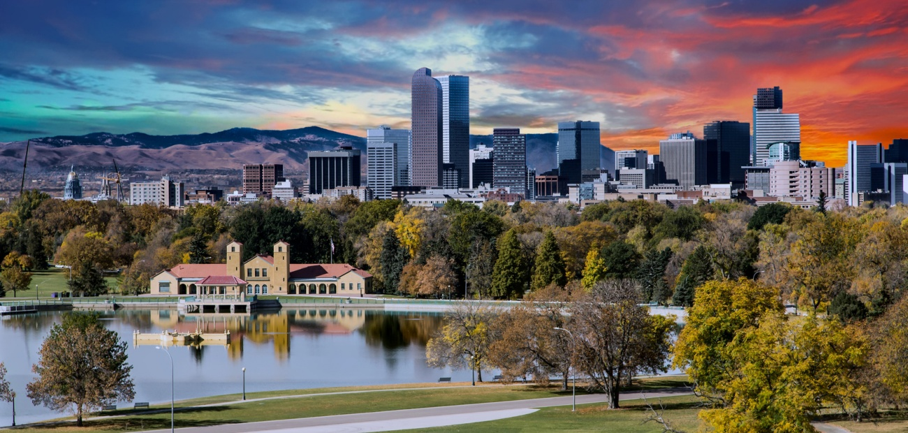 Downtown Denver with lake and mountains