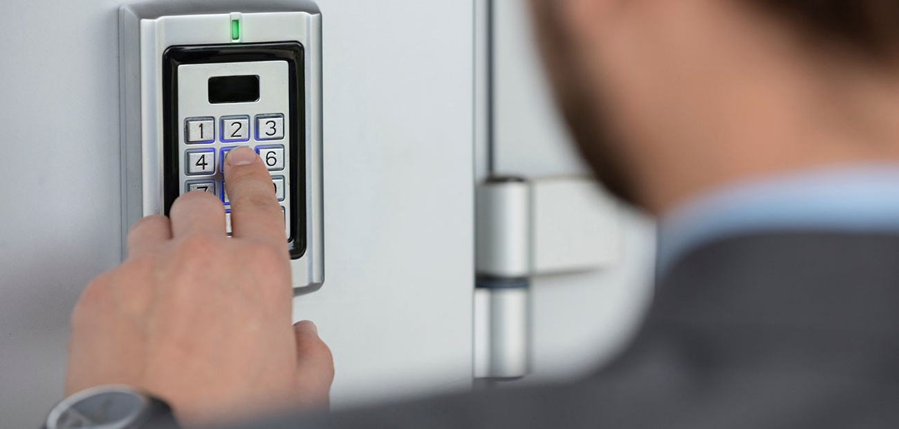 Man Using Keypad to Open Door