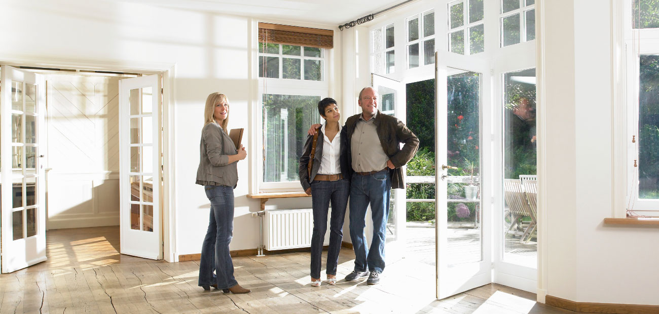 Couple With Agent in Empty House