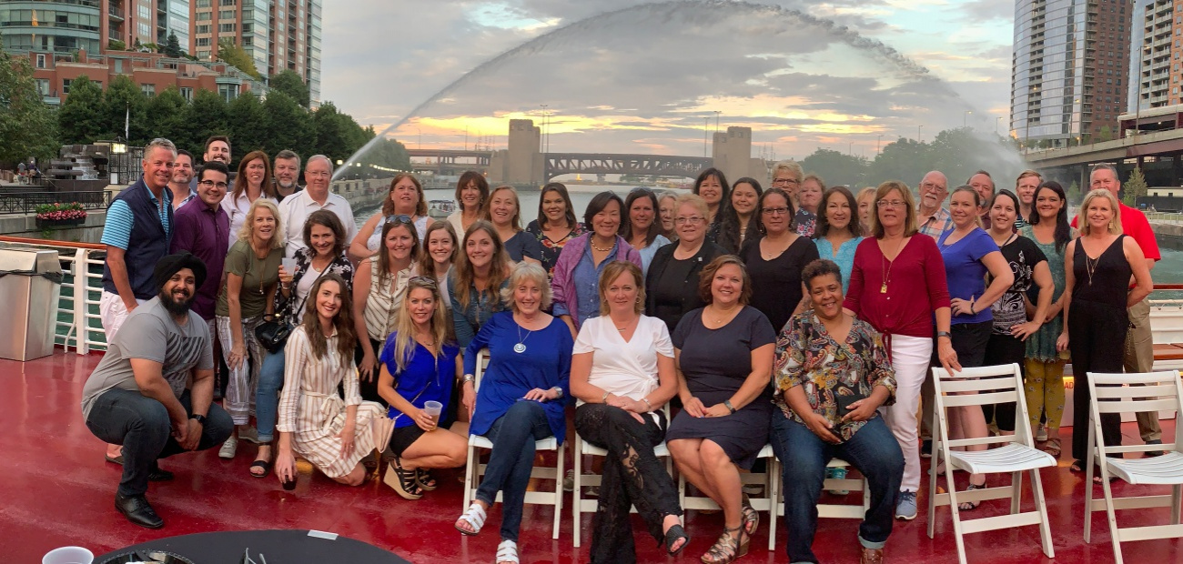 New Association Executive Orientation group picture on the Chicago river, July 2019