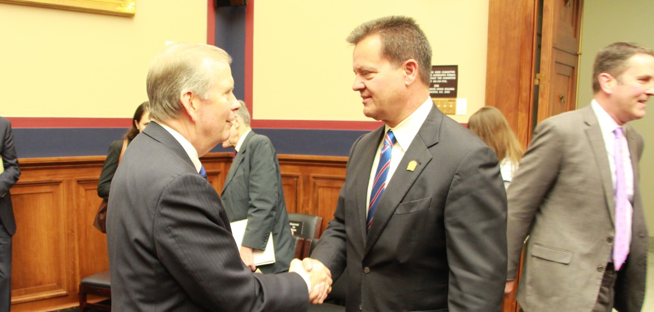 Mike McGrew shaking hands with Rep. Tim Walberg (R-MI)