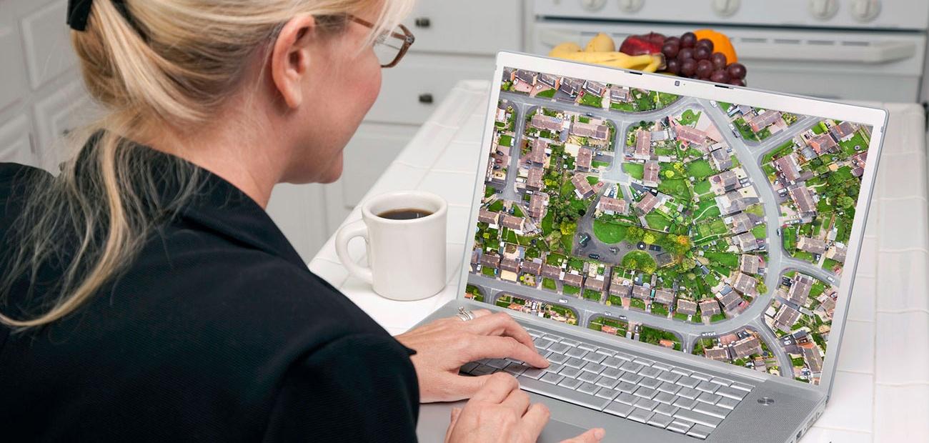 Woman Looking at Street Plan